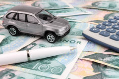 Car Finance SEK. Car finance and cost's depicted with a car, calculator and pen on Swedish 100 Kroner notes Royalty Free Stock Images
