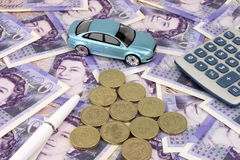 Car Finance Sterling. A luxury cars on sterling notes, with a calculator and pen. A metaphor for car finance Stock Photos
