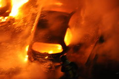 Car on fire. Car engulfed in flames and smoke royalty free stock photos