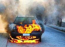 Car on fire stock image