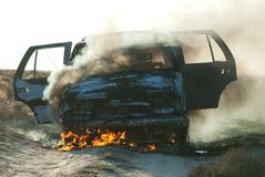 Car fire. On desert rural road Royalty Free Stock Photography