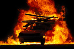Car and fire. Car is driving through fire Royalty Free Stock Photography