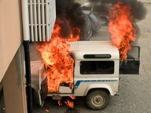 Car on fire. On the parking stock image