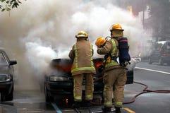 Car Fire. Firemen fight car fire stock photography