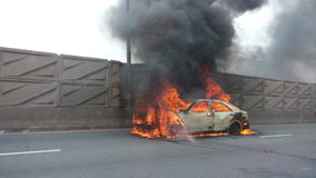 Car on fire accident street Royalty Free Stock Images