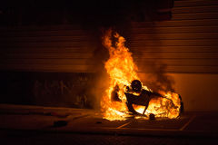 Car fire. Car catching fire, after act of vandalism in the street Stock Images