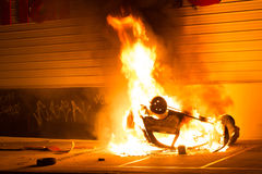 Car fire. Car catching fire, after act of vandalism in the street Stock Photo