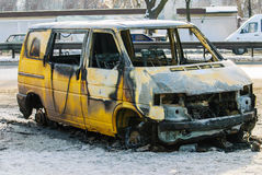 Car after fire. The car on a city street after the attack Royalty Free Stock Photo