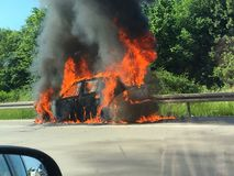 Car on fire on motorway. Car on fire on the motorway royalty free stock images