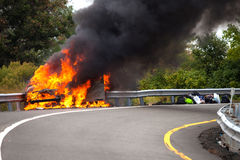 Car on fire with passengers. On highway Royalty Free Stock Image