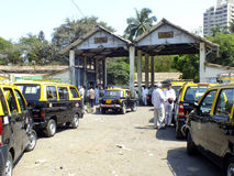 Car fitness centre in Mumbai, India. Taxis aligned, waiting for their turn, at a Mumbai car fitness centre Stock Photos