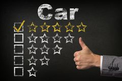 Car five 5 star rating. thumbs up service golden rating stars on chalkboard.  royalty free stock photo
