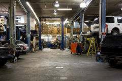 Car fixing garage. An old car fixing garage filled with cars Stock Photo