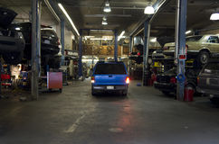 Car fixing garage. An old car fixing garage filled with cars Royalty Free Stock Images