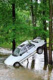 Car and flash flood. White car in water - big flash flood royalty free stock photos