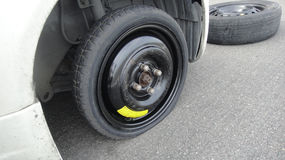 Car flat spare wheel Royalty Free Stock Photography