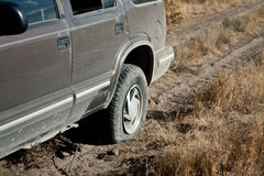 Car With Flat Tire. A car , SUV,in the desert with a flat tire royalty free stock photography