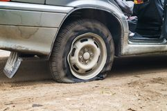 Car flat tire on a bad road. Need to repair Royalty Free Stock Image
