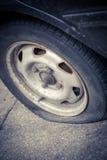 Car flat tire Stock Photos