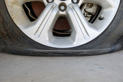 Car flat tire Stock Photography