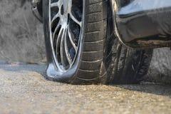 Car flat tire in rainy day Royalty Free Stock Photo