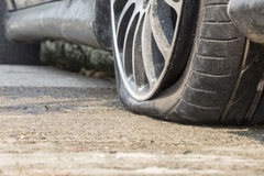 Car flat tire on road Stock Photo