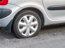 Car with Flat Tyre Stock Image