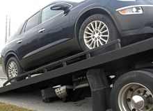 Car on a flatbed truck Stock Photography