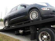 Car on a flatbed truck Stock Photo