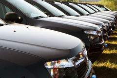 Car fleet. Identical cars parked in line Royalty Free Stock Image