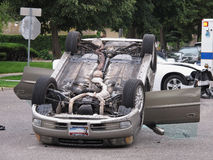 Car Flipped Over. Car crash accident left one care flipped over royalty free stock photos