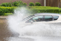 Car in flooded street Stock Images