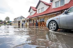 Car on a flooded street royalty free stock image