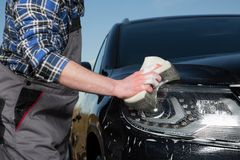 Car floodlight cleaning Stock Photos