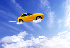 Car flying on blue sky background. Royalty Free Stock Image