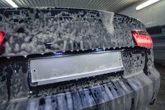 Car in foam on sink Stock Image