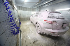 The car in the foam Royalty Free Stock Photo