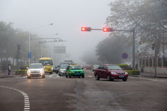 Car in fog at city road Stock Photography