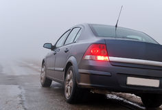 The car on a foggy road Royalty Free Stock Images