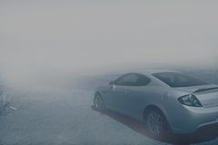 Car on foggy road