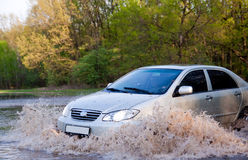 Car forces water Royalty Free Stock Images
