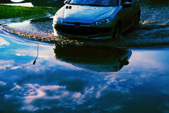 Car forcing the flood waters. Car driving into the flood waters Royalty Free Stock Photo