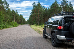 Car in the forest road. Black Offroad car in the forest road Royalty Free Stock Image