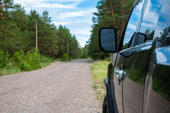 Car in the forest road. Black Offroad car in the forest road Royalty Free Stock Photo
