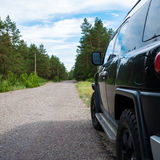 Car in the forest road Royalty Free Stock Photos