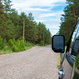 Car in the forest road. Black Offroad car in the forest road Royalty Free Stock Photography