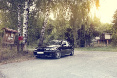 Car on forest road, BMW 3 E46 330Ci Stock Image