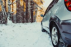 The car in the forest in winter Royalty Free Stock Image