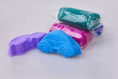 A car formed from blue play dough plasticine. Modeling. royalty free stock images