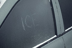 Car after freezing rain with inscription scratched ice Royalty Free Stock Images